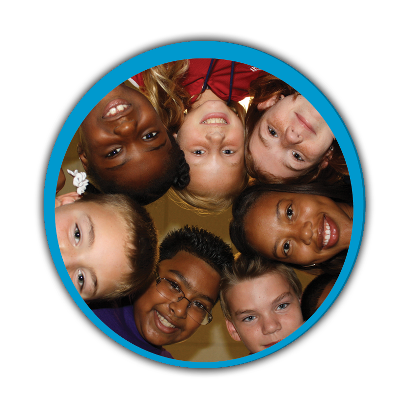 A diverse group of children in a circle smiling for the camera
